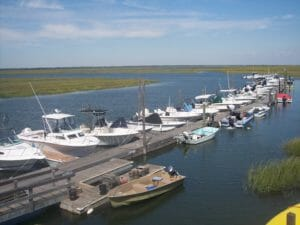 one of the Whale Creek Marina docks with line of boats at slips