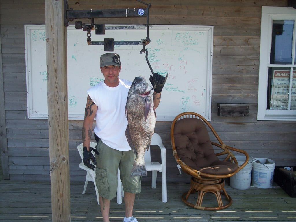 Happy customer and his catch on the dock at Whale Creek Marina in 2011