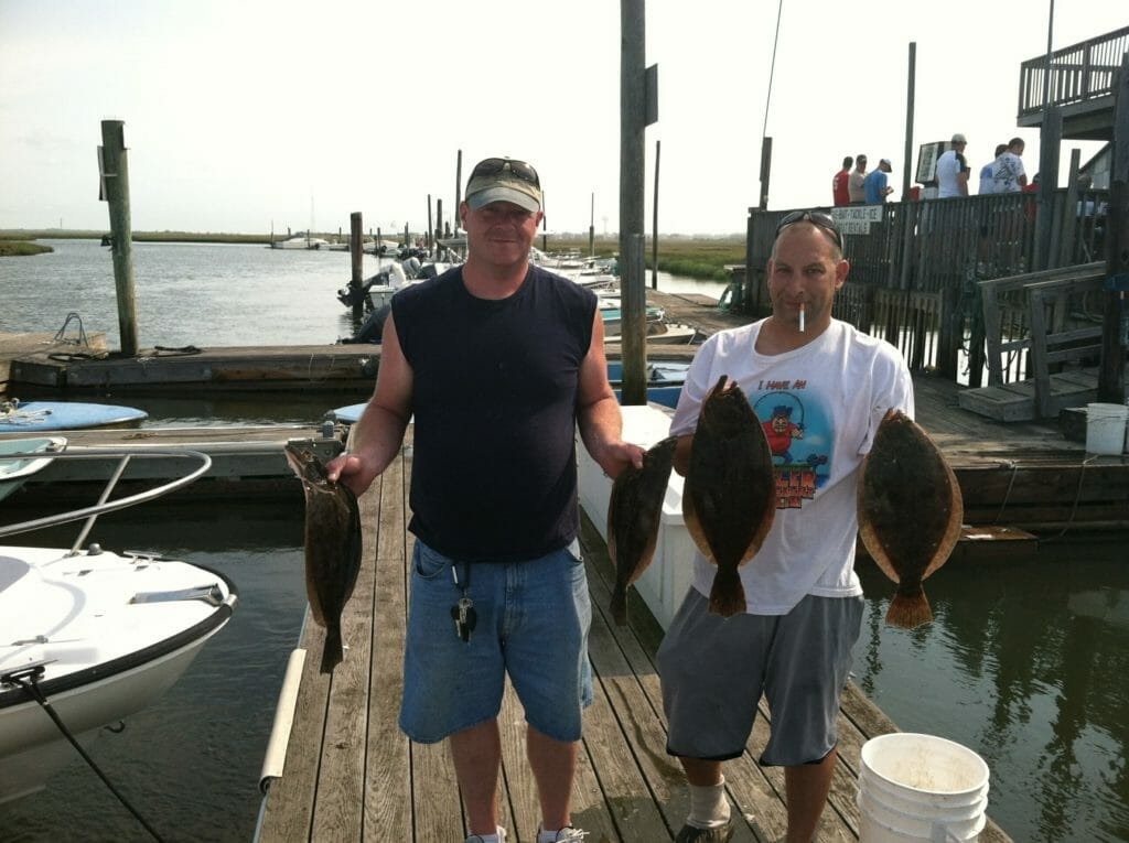 Photos of customers with their catch on the dock at Whale Creek Marina in 2012