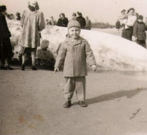 Little kid in front of beached whale on Whale Beach in Strathmere 1950's