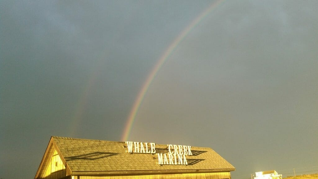 rainbow over the Whale Creek Marina sign on our shed after a storm