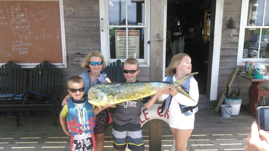 kids and their catch on the dock at Whale Creek Marina